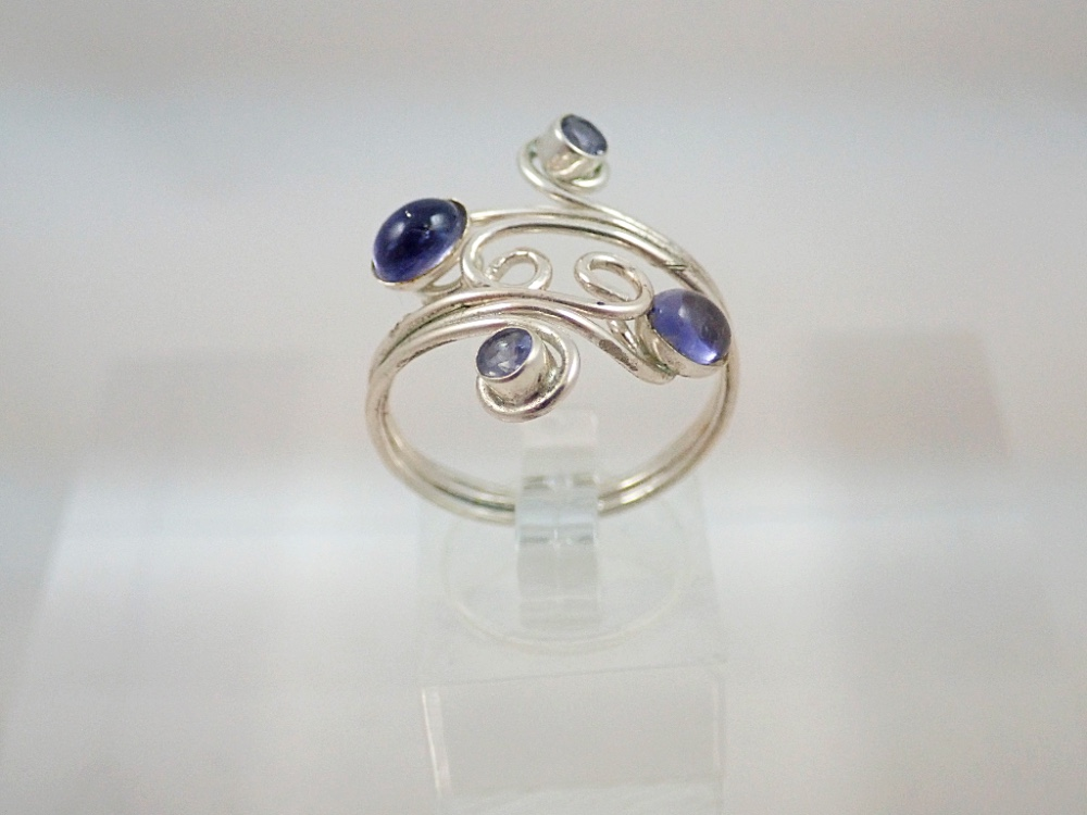 iolite cabochon and facet  ring with curls