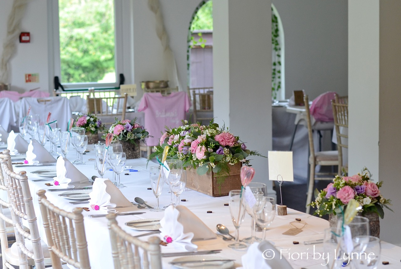 top-table-of rustic-wooden-boxes,pink,lilac+white-flowers-rustic-style.jpg