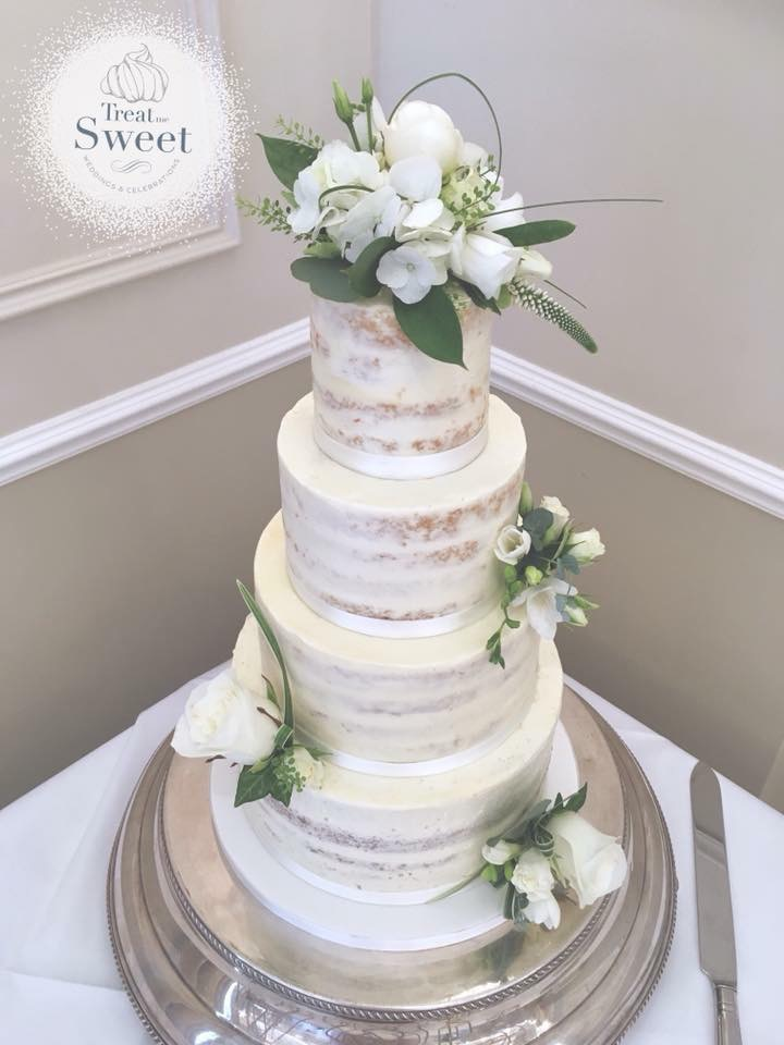4 tier semi naked wedding cake with fresh flowers - Treat me Sweet