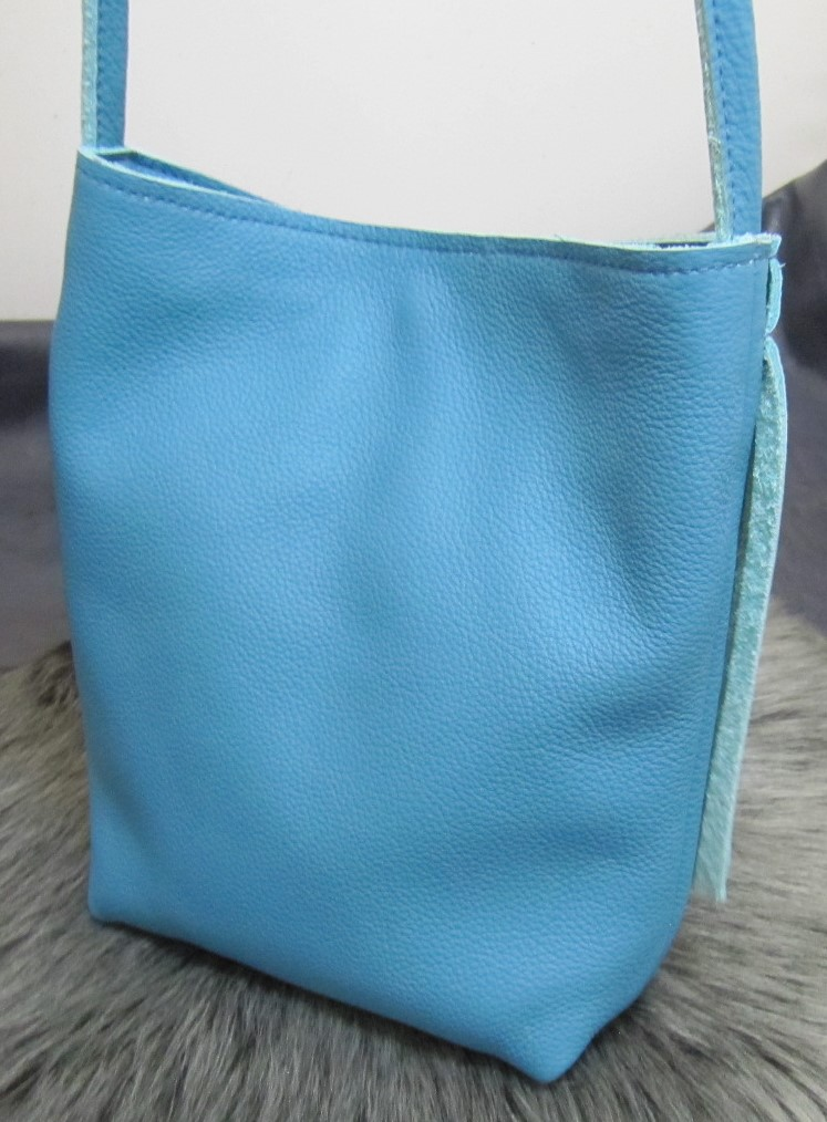 Small fringed turquoise leather bag