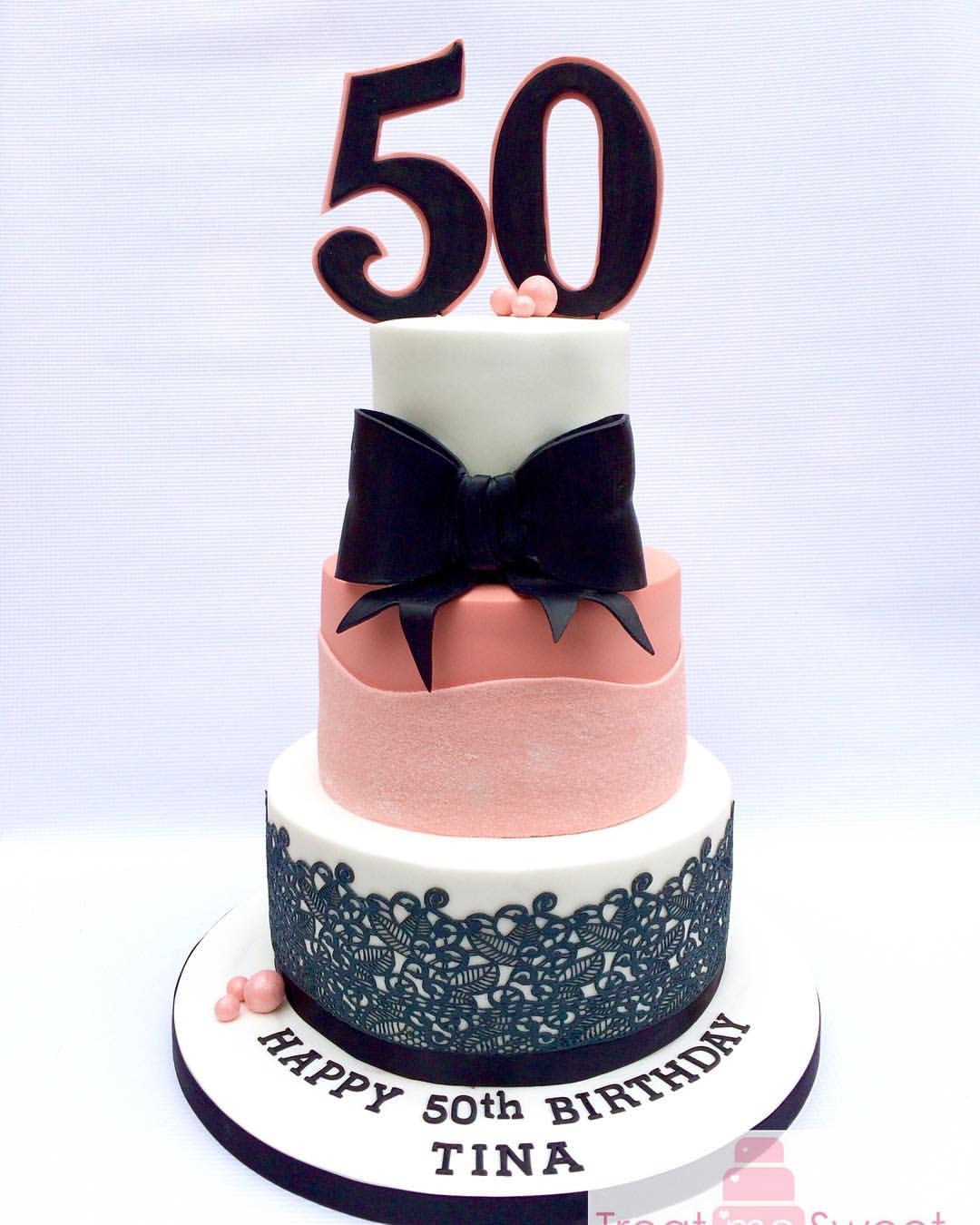Tiered Pink, white and black cake with large bow and edible lace - Treat me Sweet