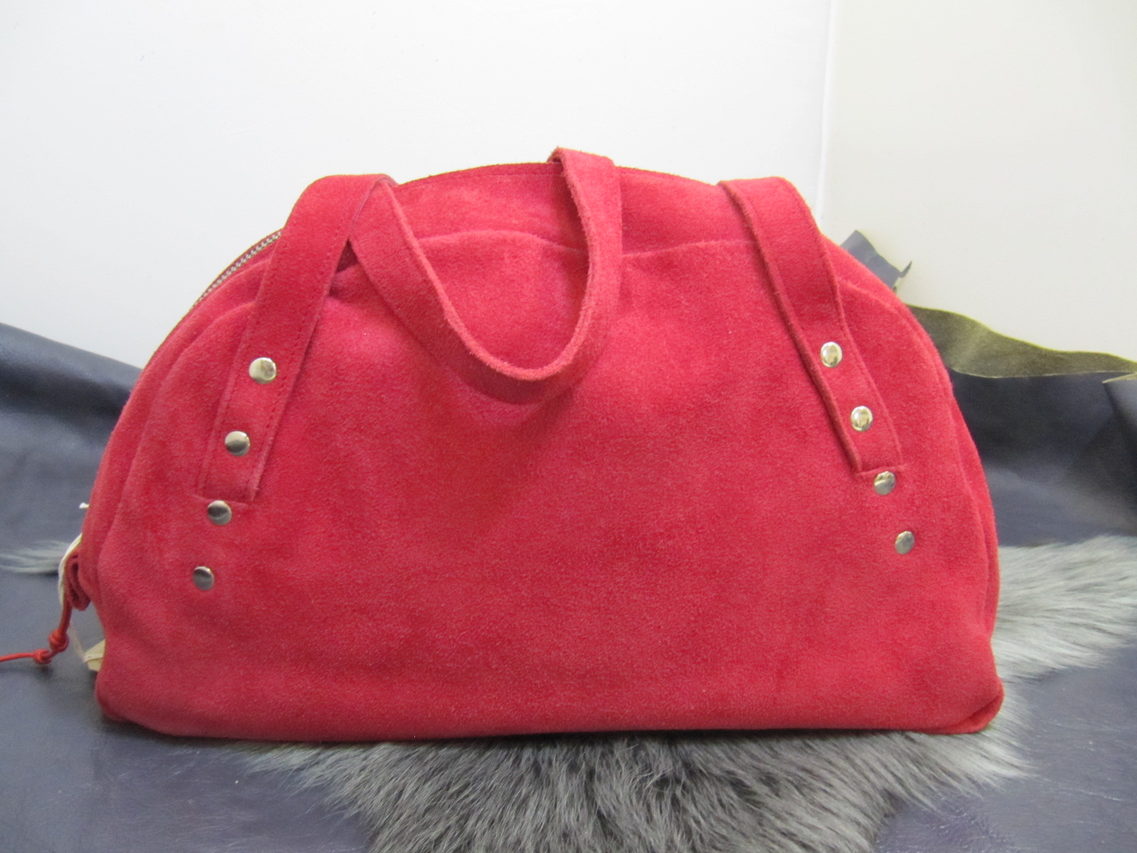 Red suede half moon handbag
