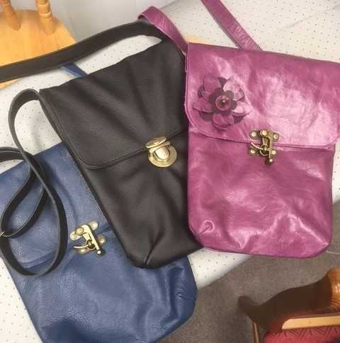 Three bags made at a workshop