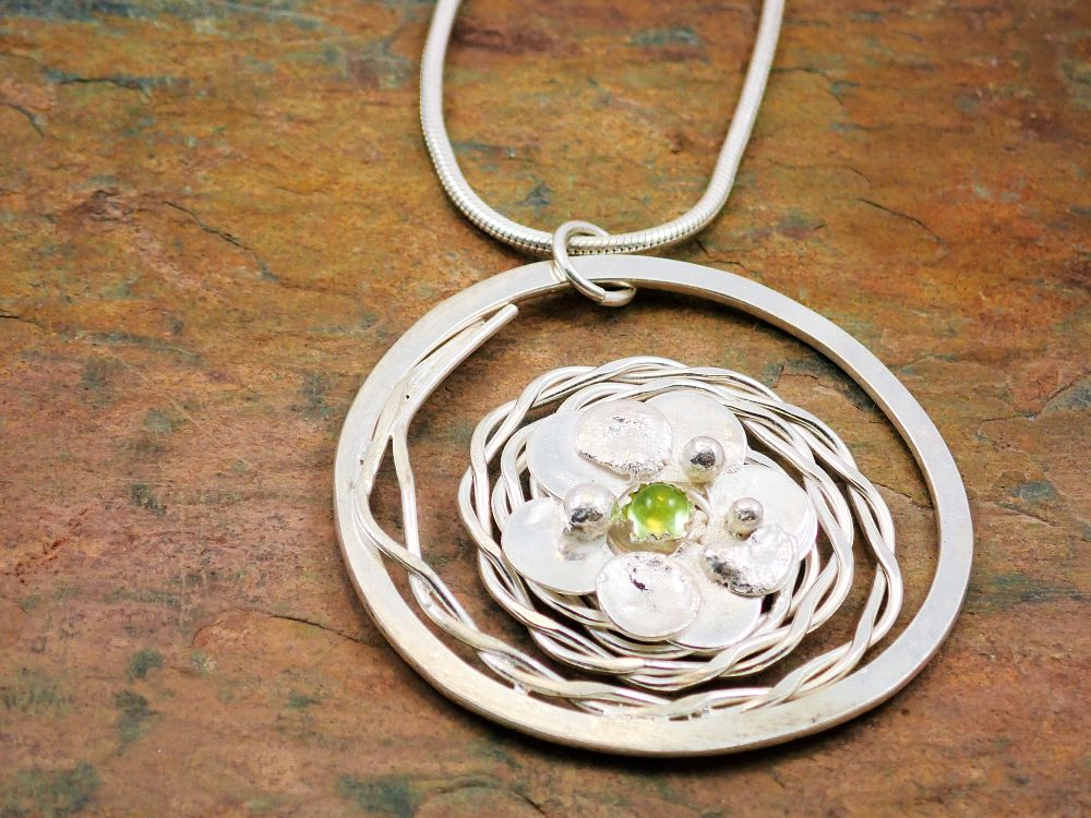 Peridot spiral and flower pendant