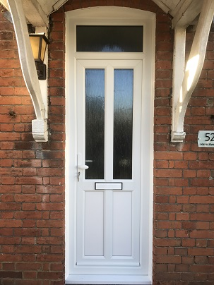 White PVCu panel door and double glazed top light