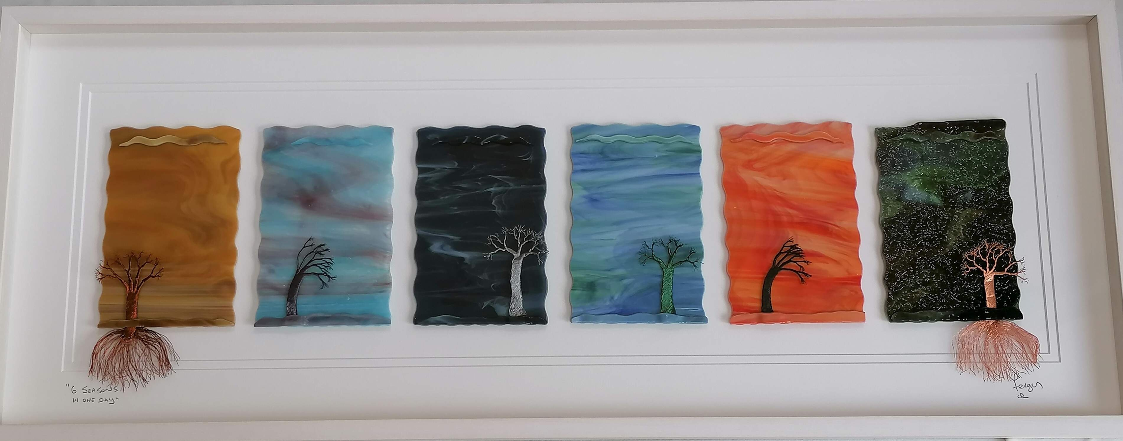 6 Panels of dramatically coloured glass representing Drifting clouds  with copper trees