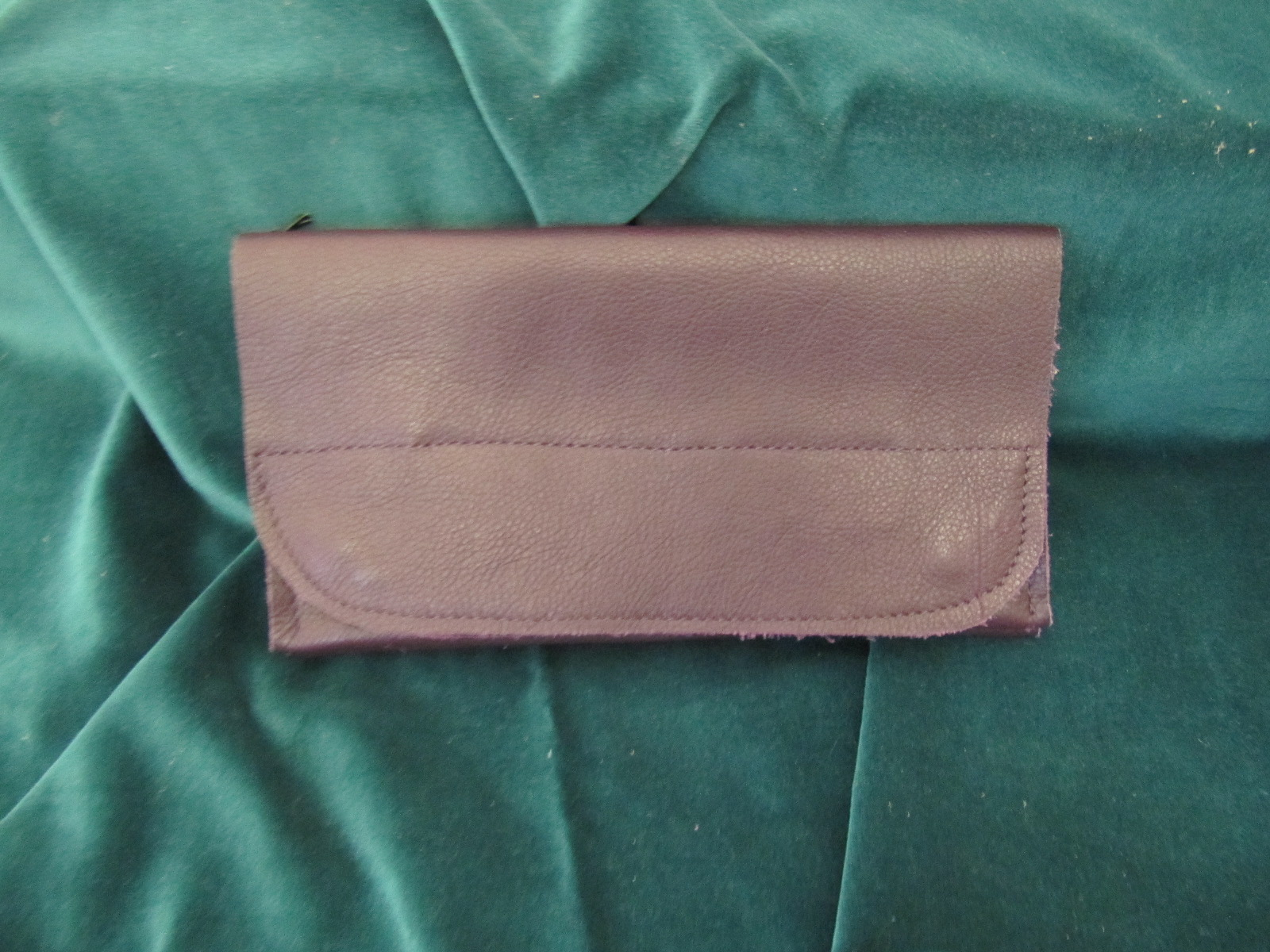Wallet in soft dark purple leather