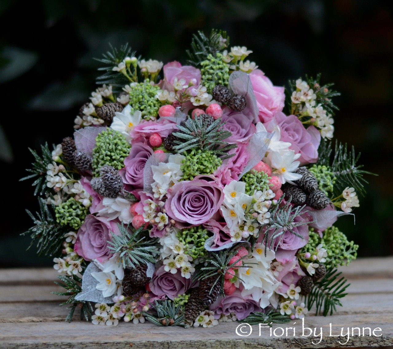 Winter bouquet with rose,pine.fir-cones,skimmia, berry,waxflower+snow.jpg
