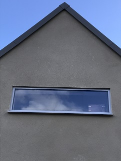 Fixed window into rendered gable end