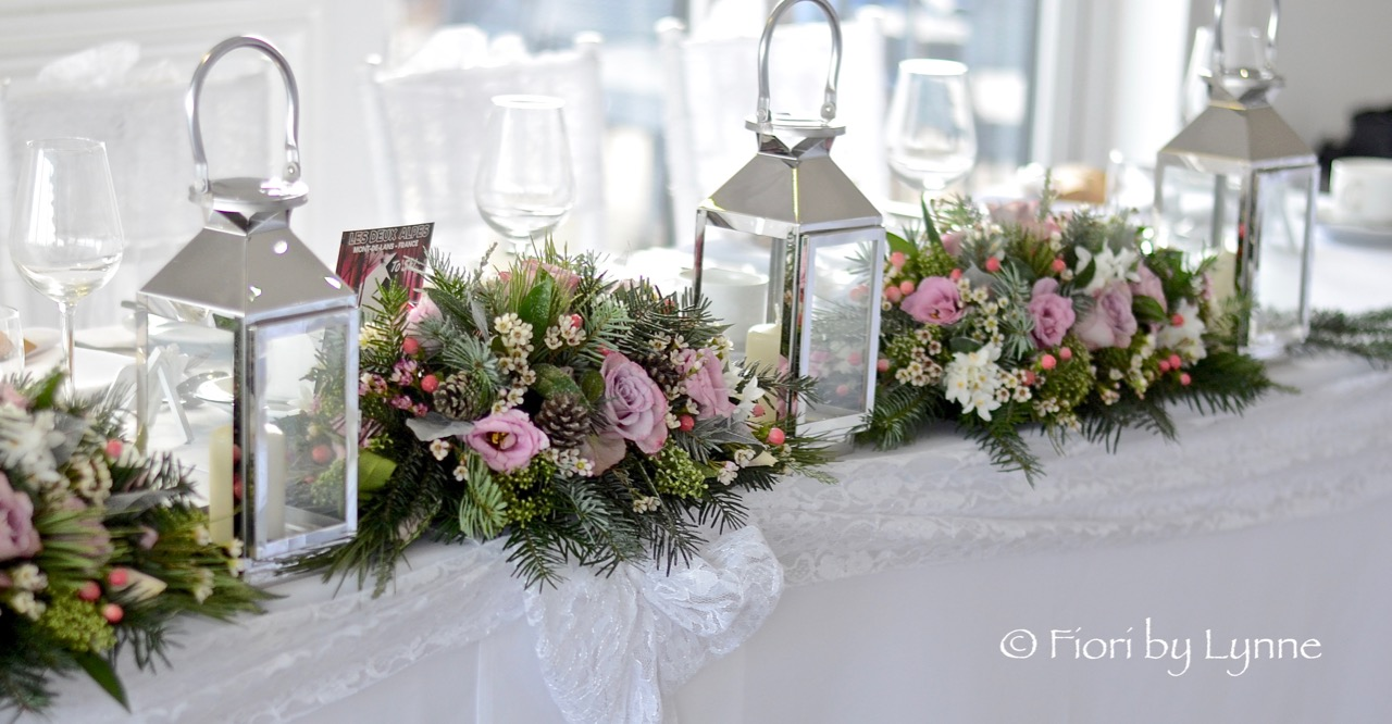 toptable-flowers-with-lanterns,Christmas-winter-wedding.jpg