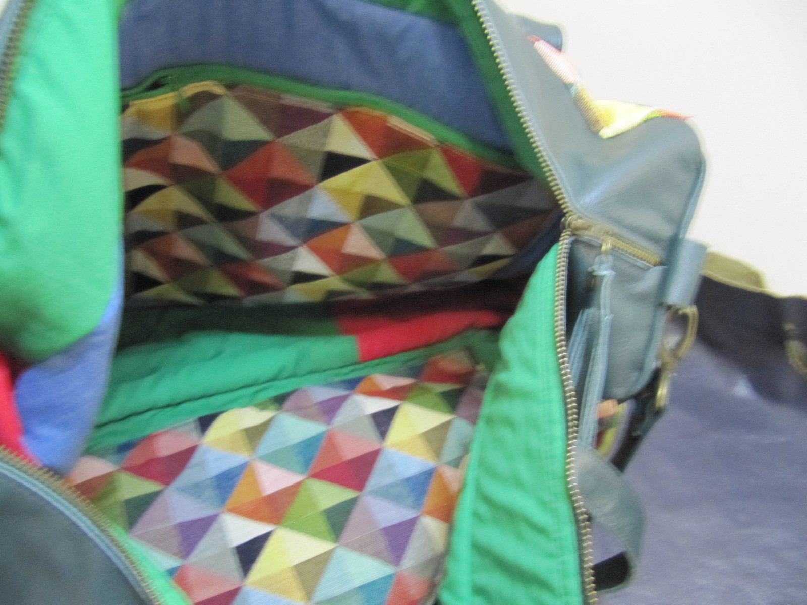 Travel/flight bag in harlequin fabric and green leather