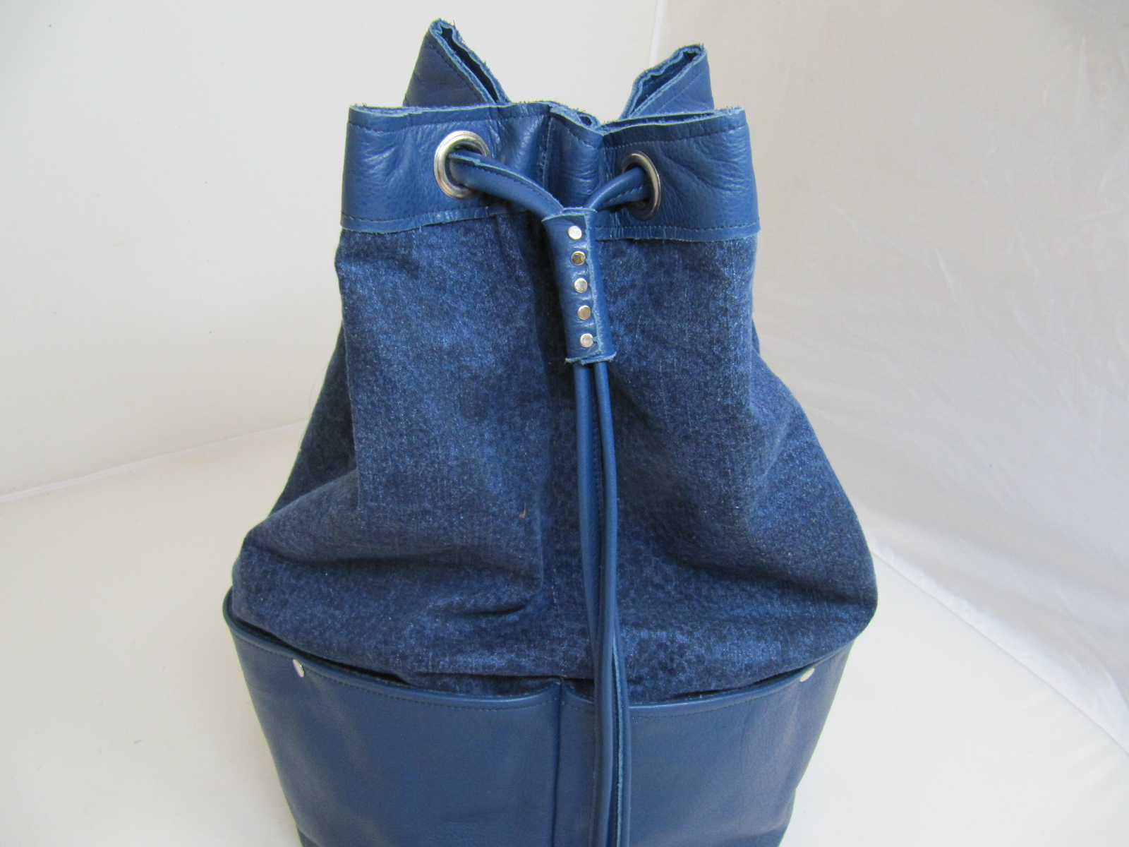 Denim and blue leather duffle bag