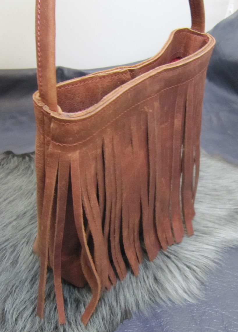 Small fringed vintage rust leather bag