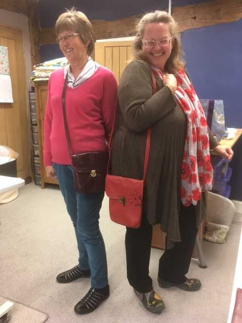Two happy clients with the bags they made!