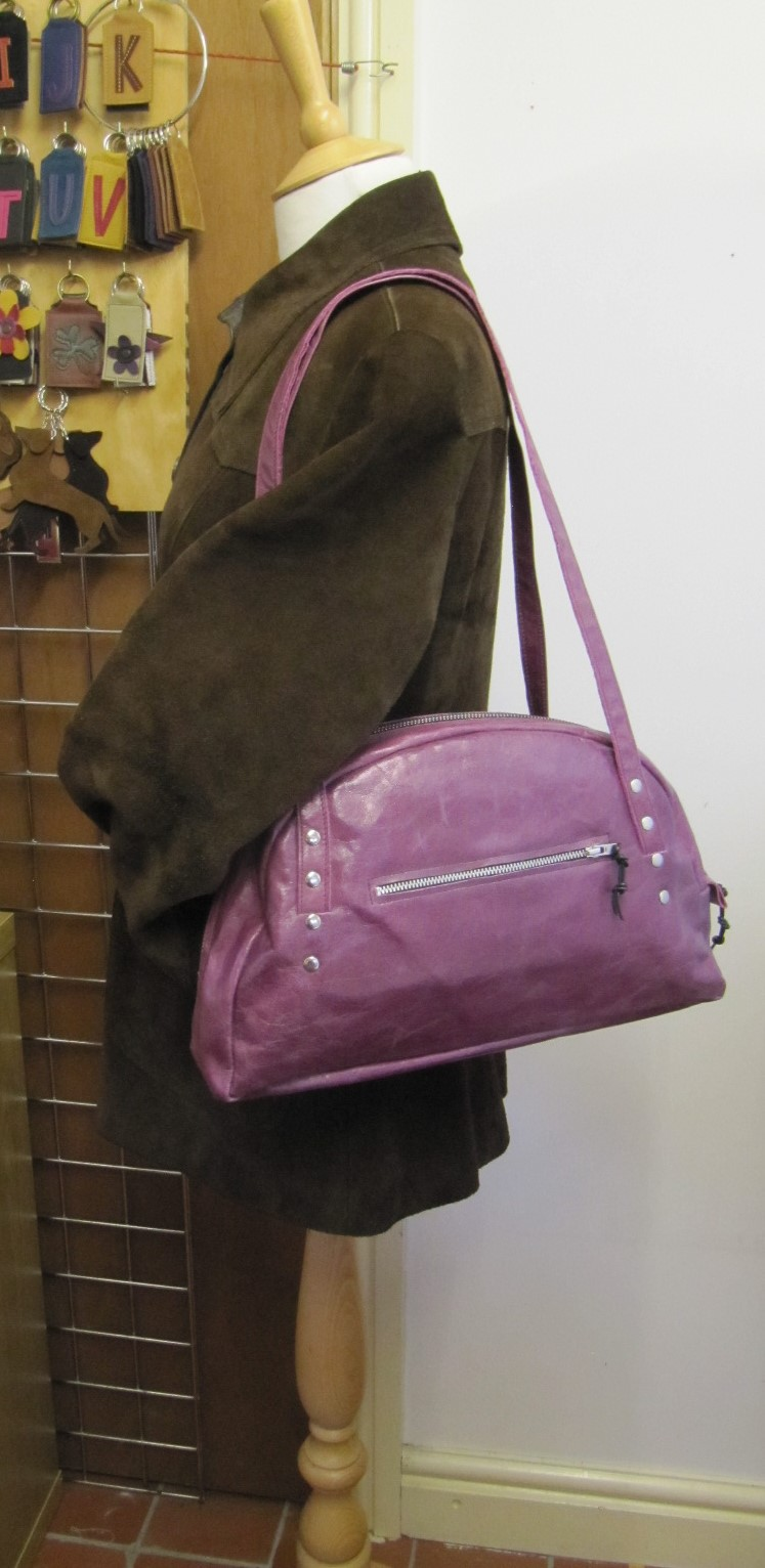 Purple leather half moon handbag