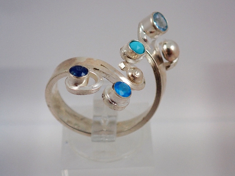 Topaz, iolite and turqoise curl ring