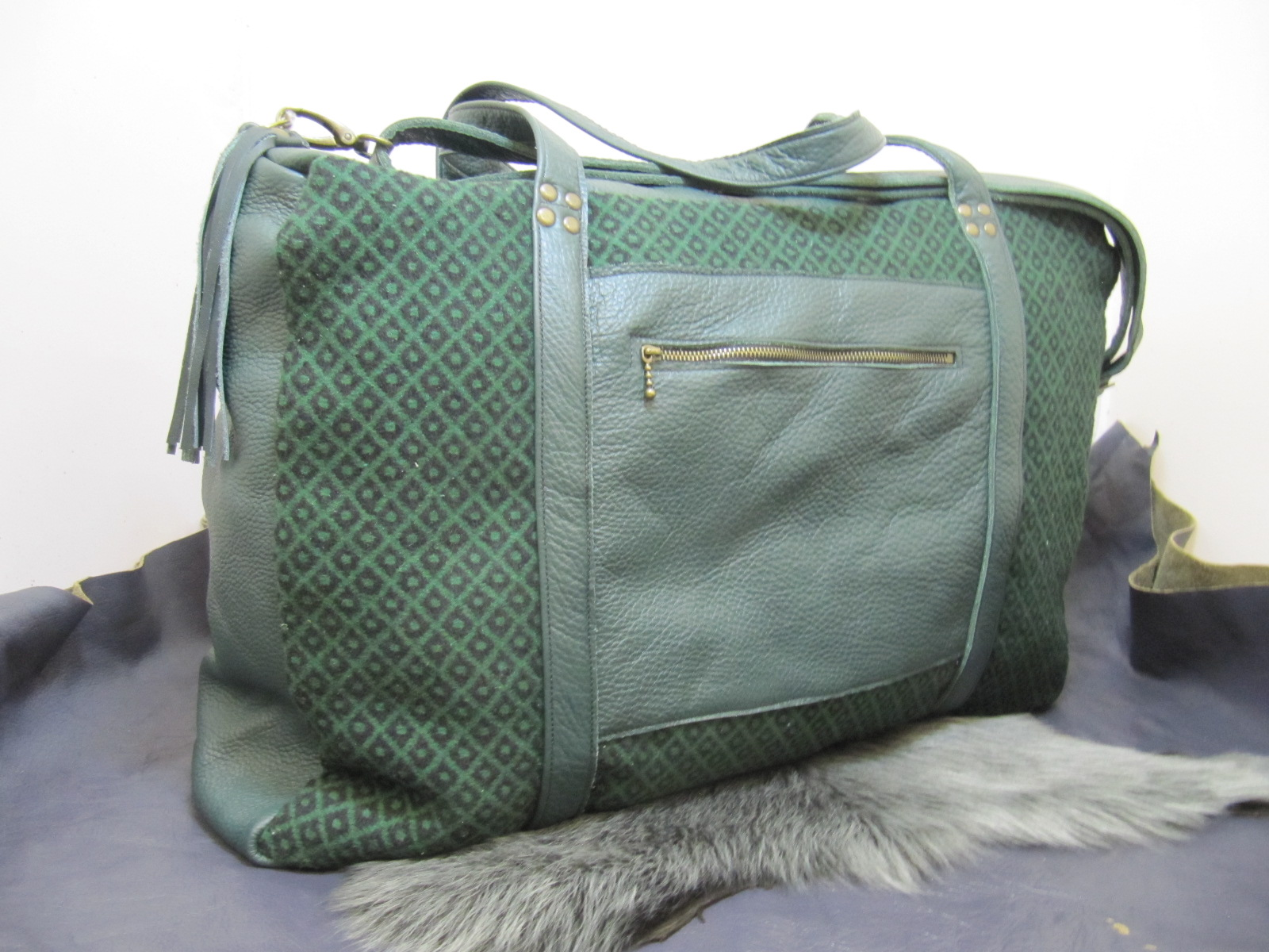 Travel flight bag in Welsh tweed and green leather