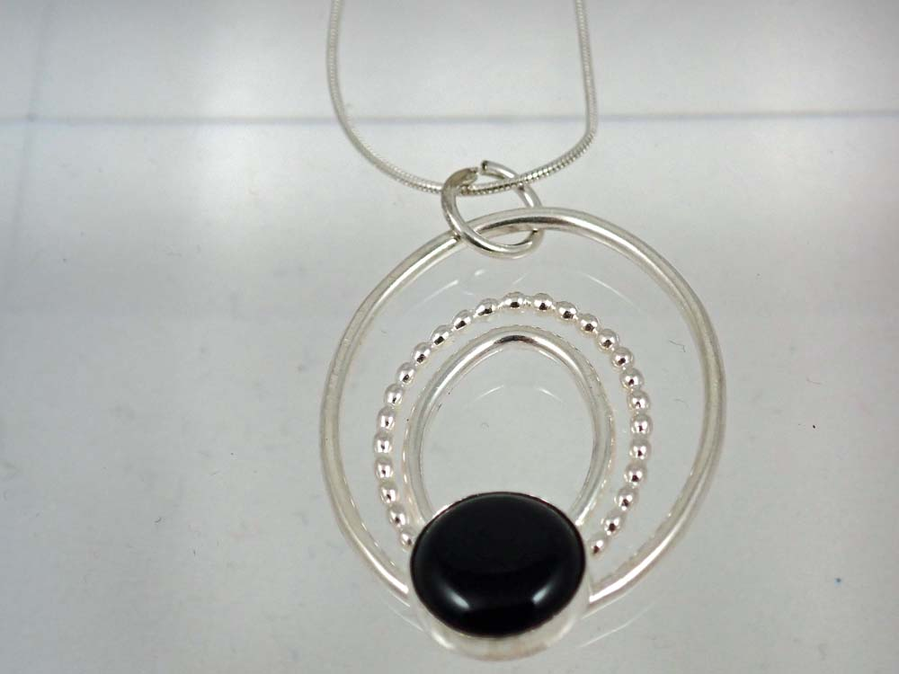Black onyx 3 oval pendant with beaded wire