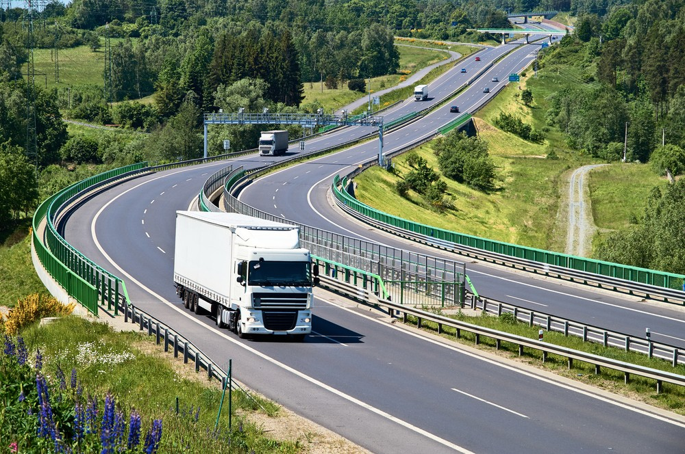 Lorry driving on road.