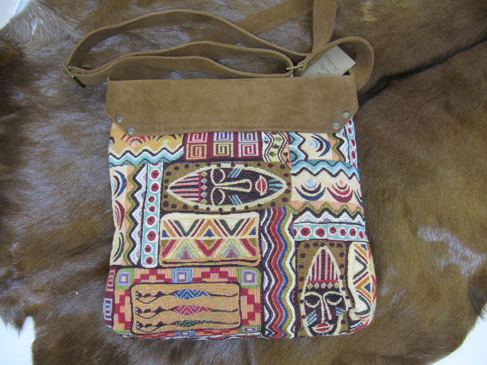 Messenger bag in African print fabric and ginger sueded