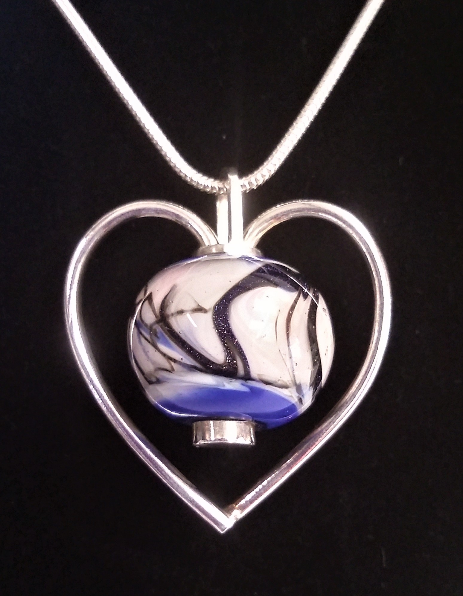 Glass bead and sterling silver necklace with a sterling silver chain. Priced at £47.50