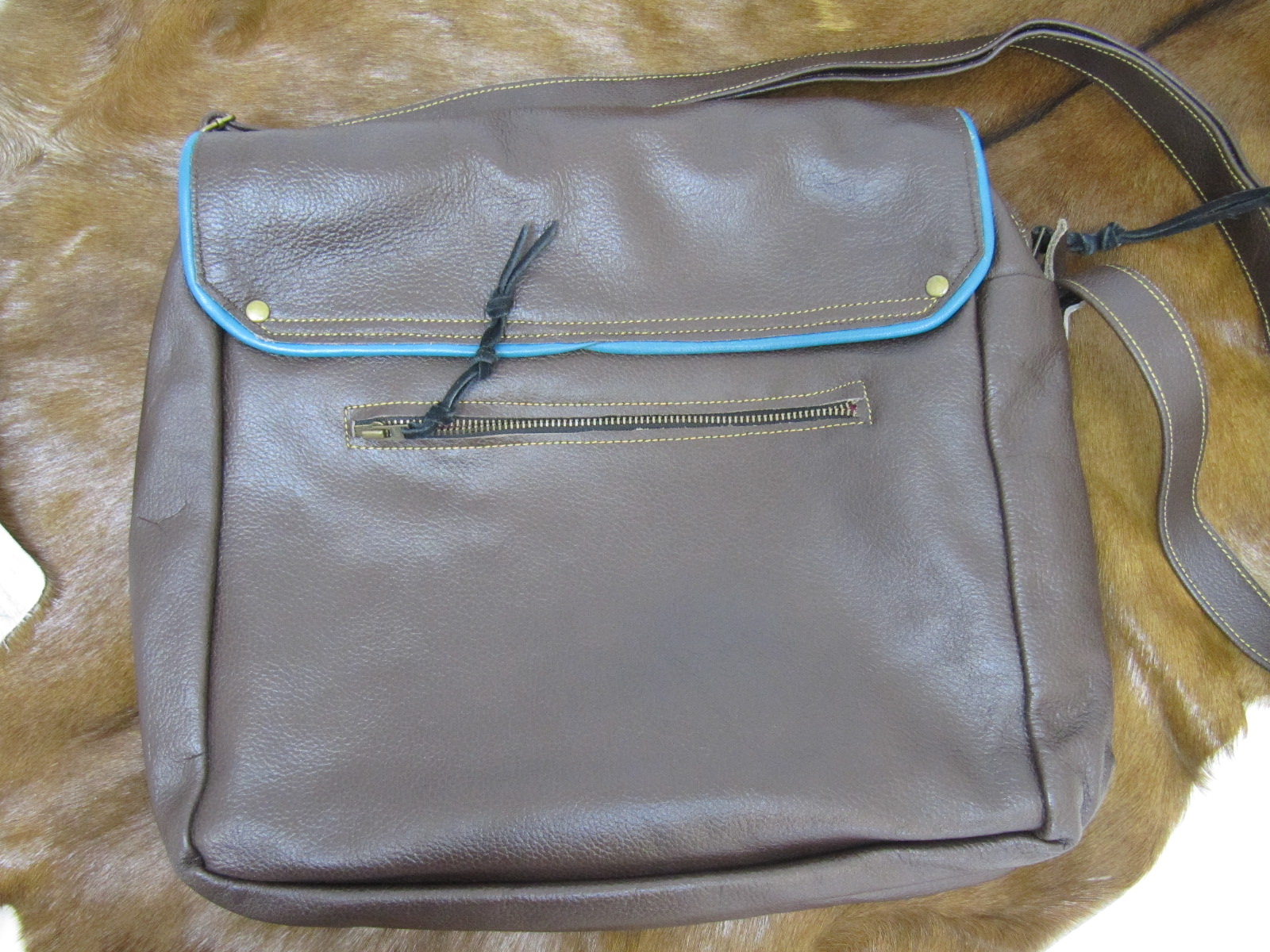 Large brown leather handbag with colourful piping
