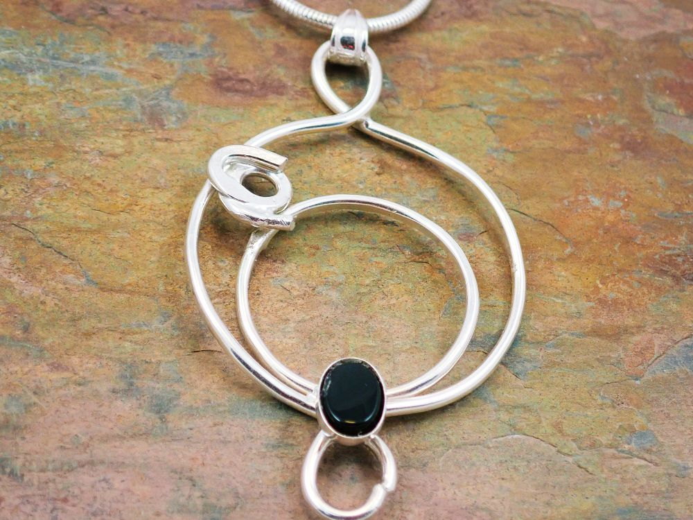 Black onyx double pendant with 'rose'