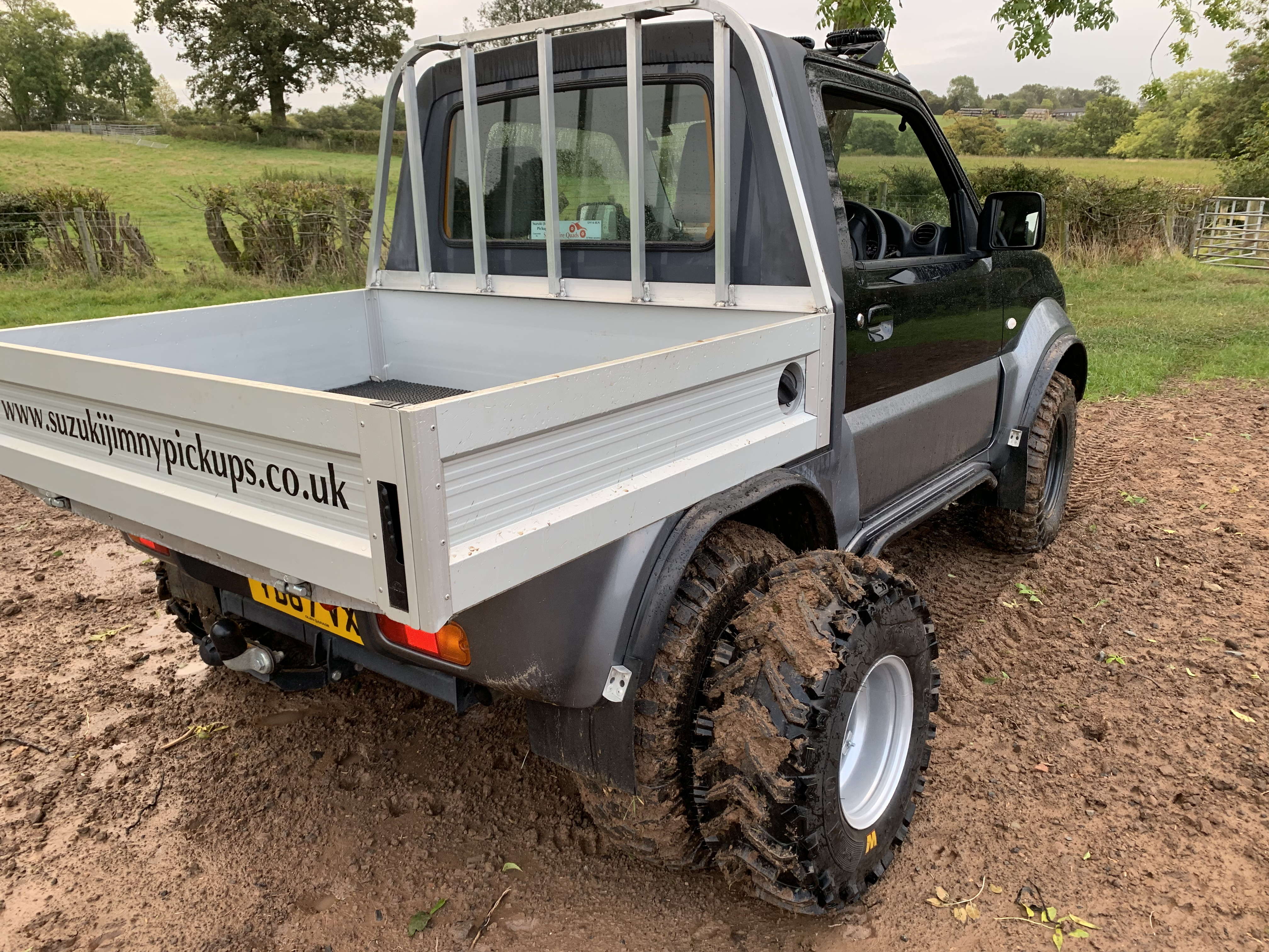 Suzuki Jimny pickup with dual wheel system fitted.