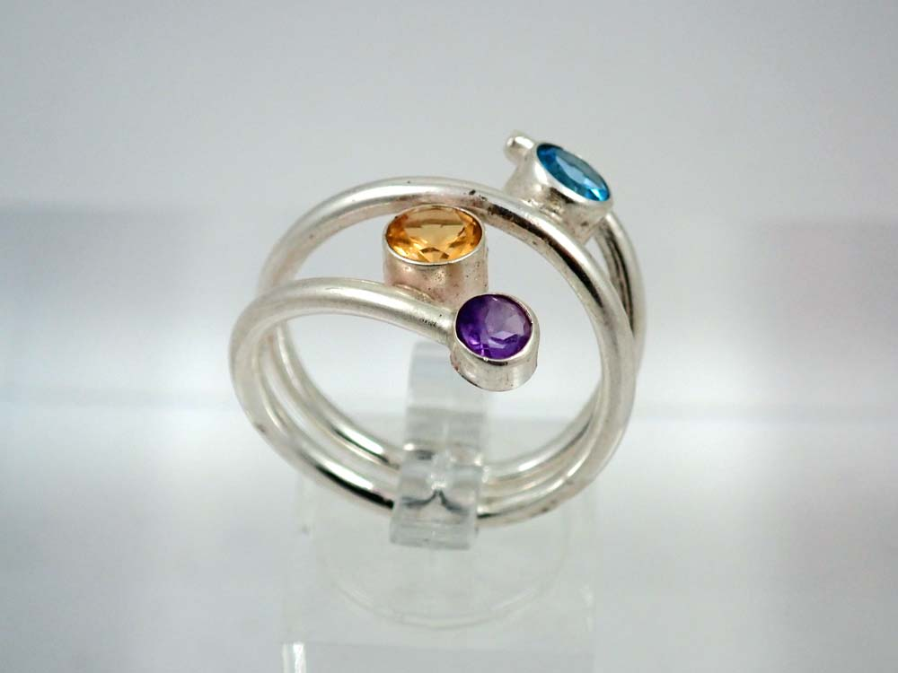Circlular open ended ring with topaz, citrine and amethyst
