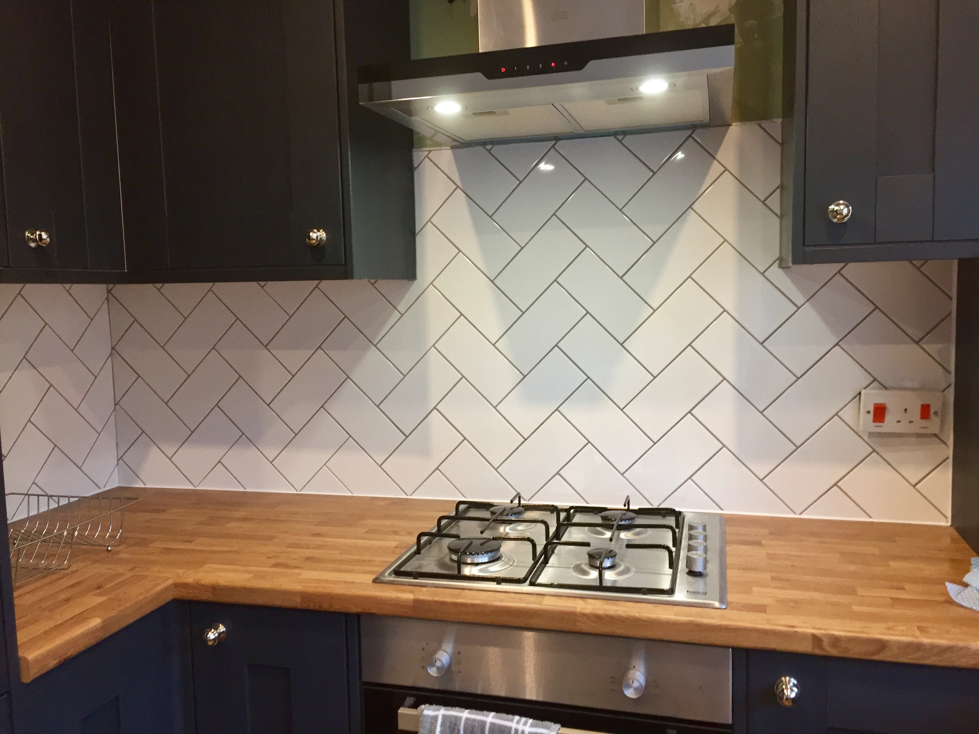 Herringbone splash back.