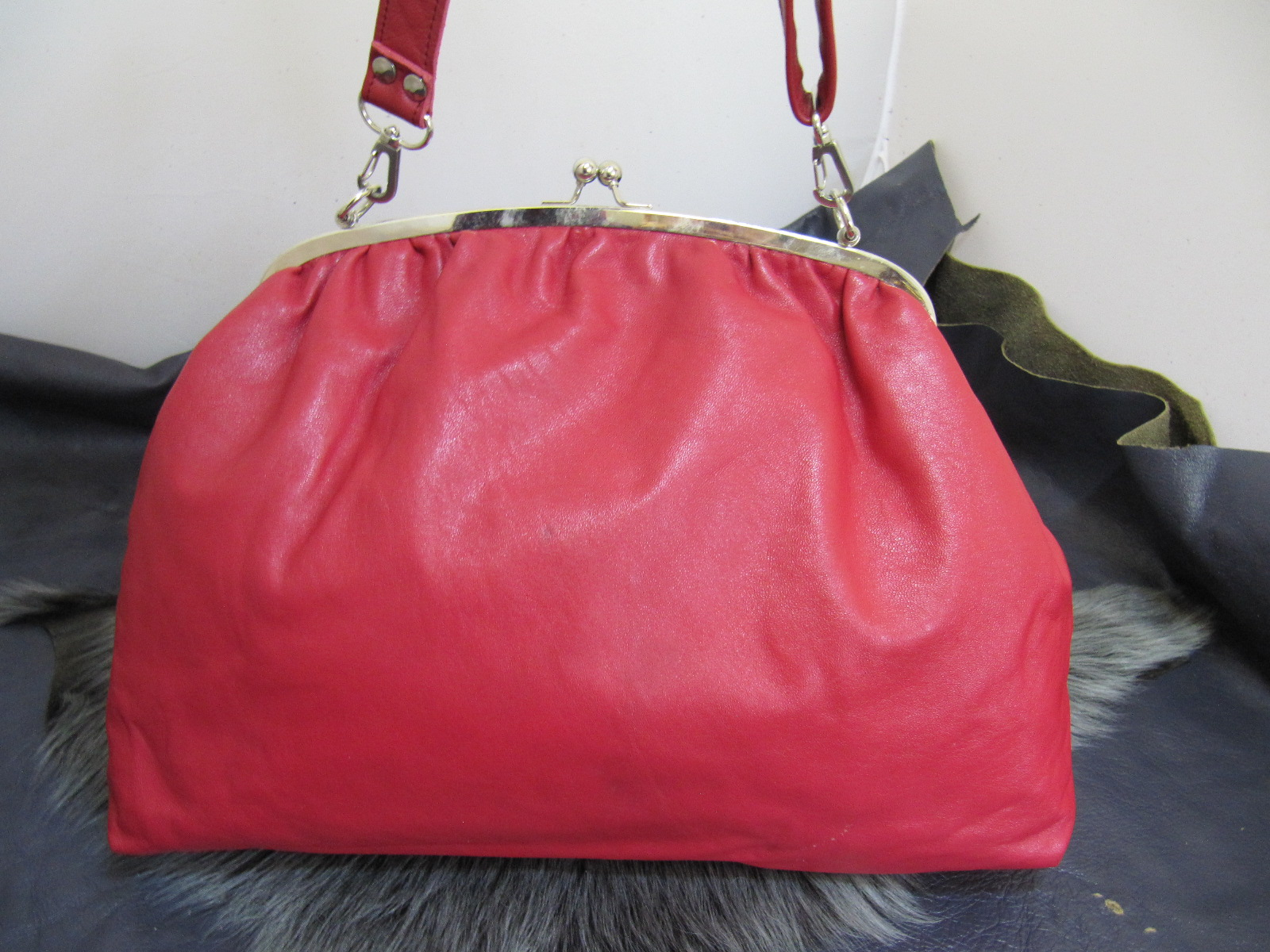 Large red leather clasp top bag