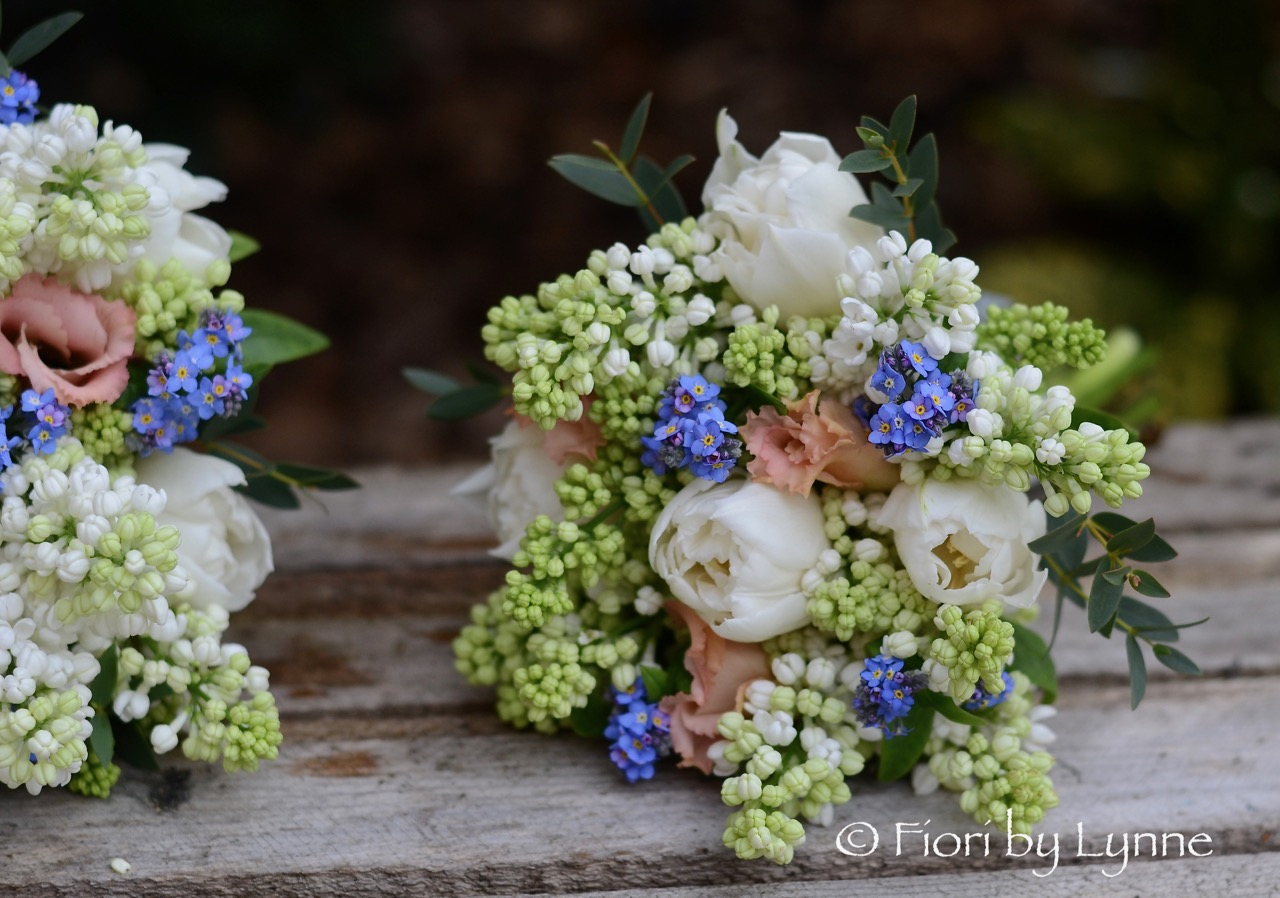 flowerGirl-posy-Spring,whiteLilacs,tulips,blue-forget-me-not,peach-lisianthus.jpg