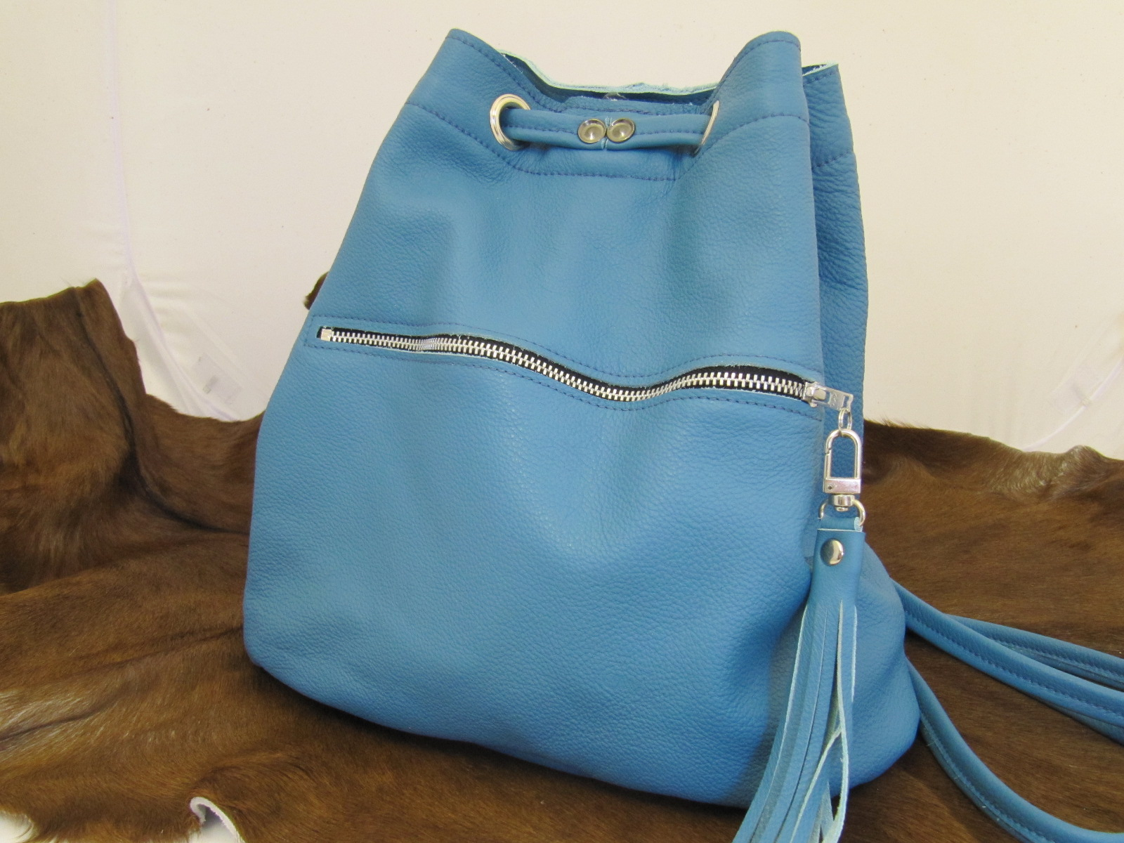 Turquoise leather duffle bag