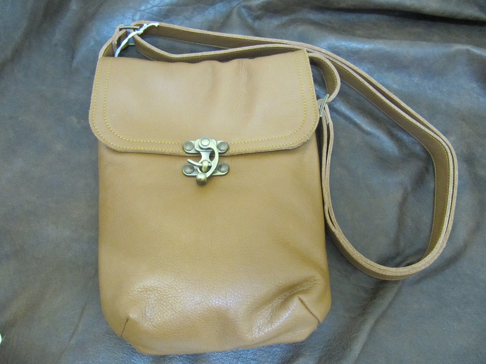 Small messenger bag in tan leather