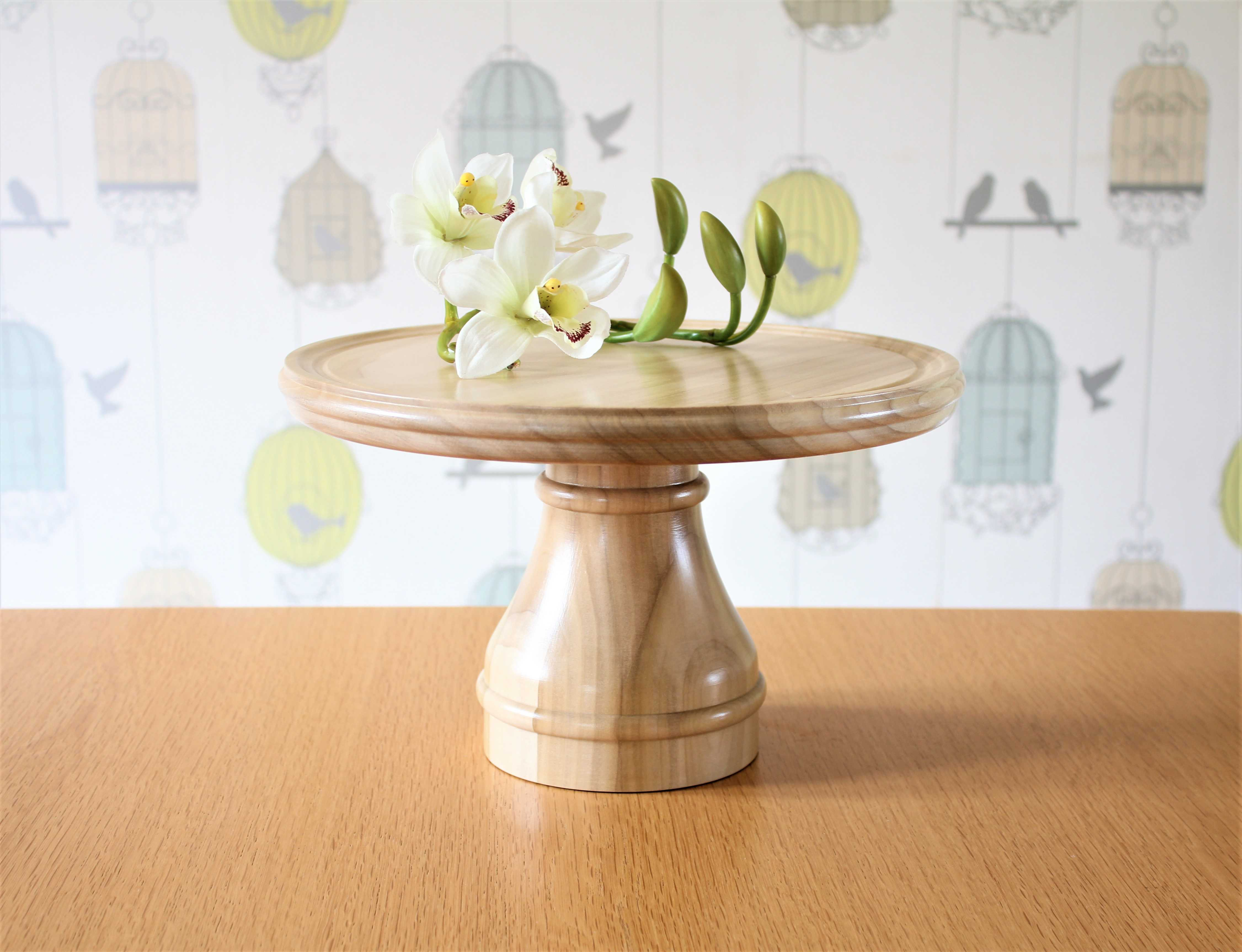 Turned from Tulipwood this cake stand is 31cm wide, comfortably sitting a 10 inch round cake board.