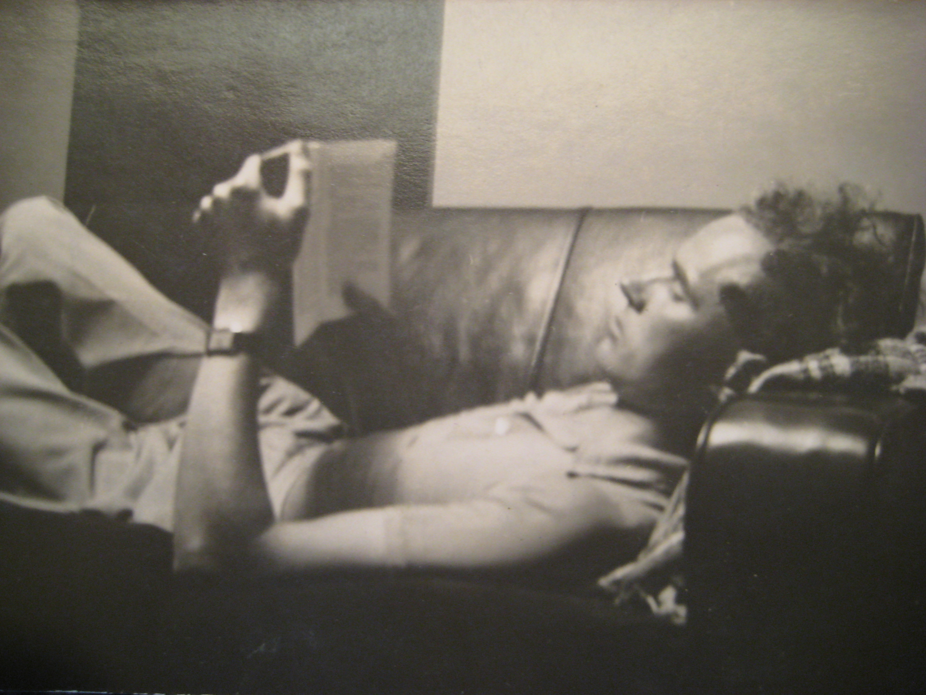 Dan Billany relaxing with book