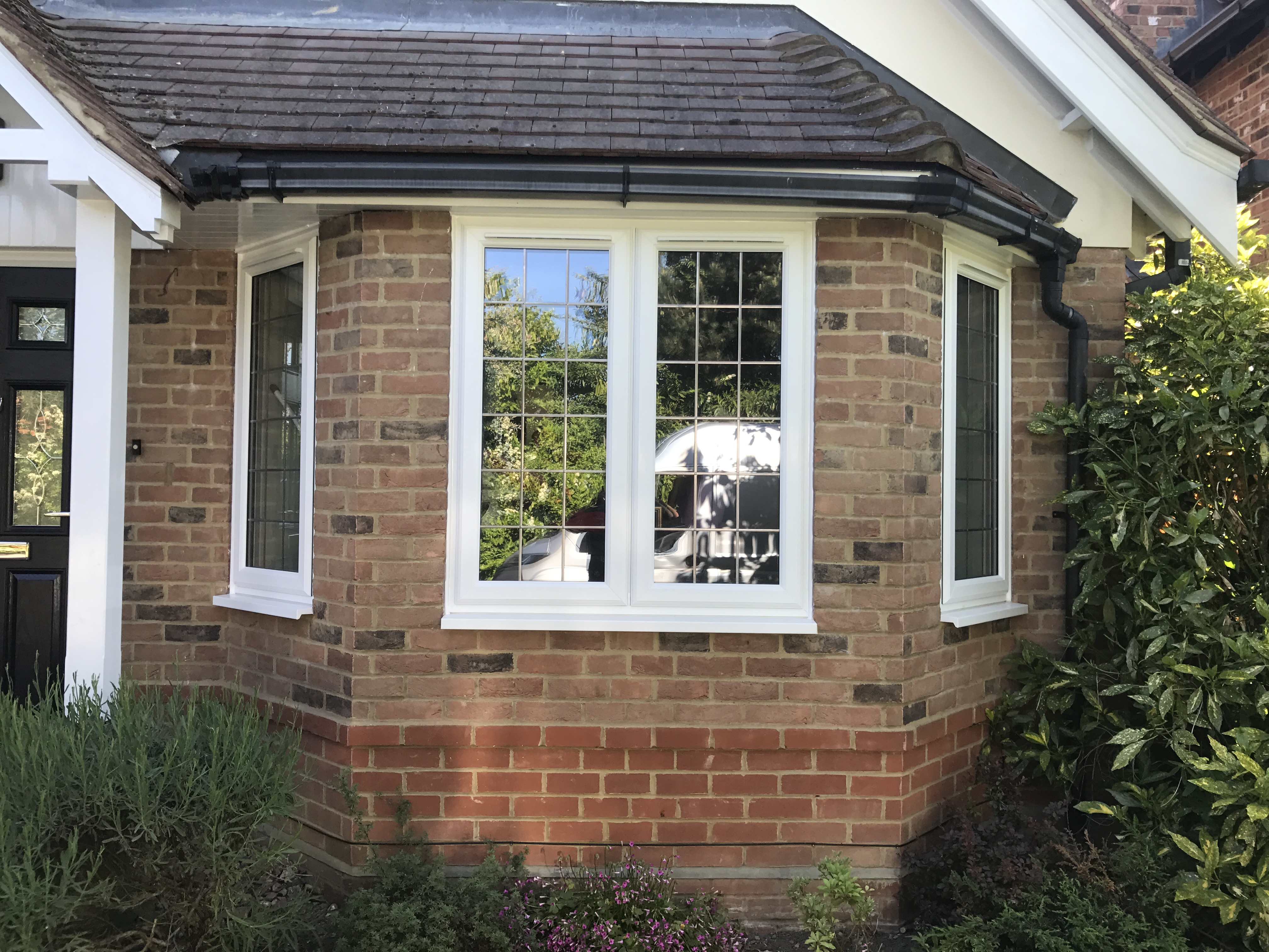 PVCu window with dummy sashes and trickle vents with square leads to private house
