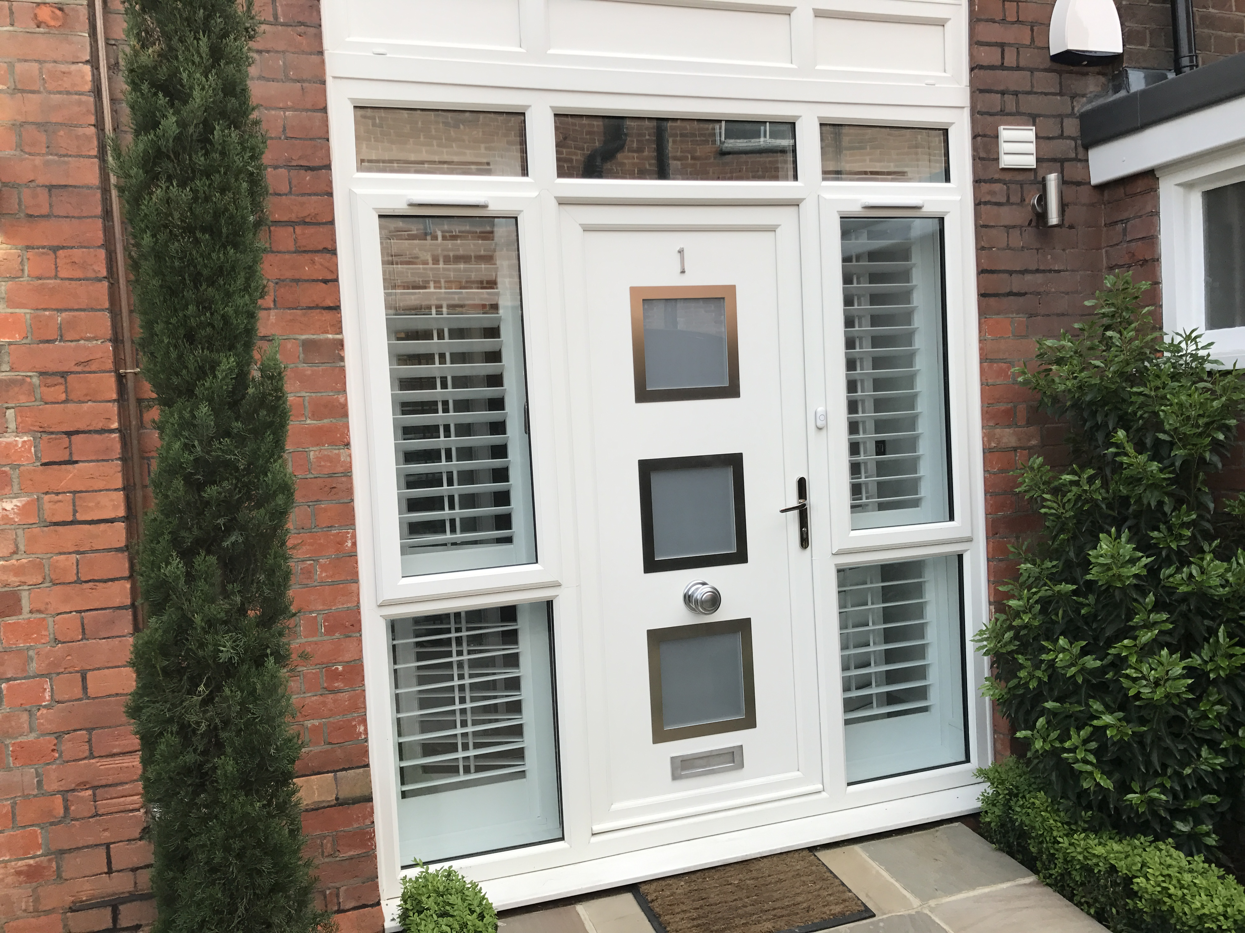 Door and surround fitted to flat entrance