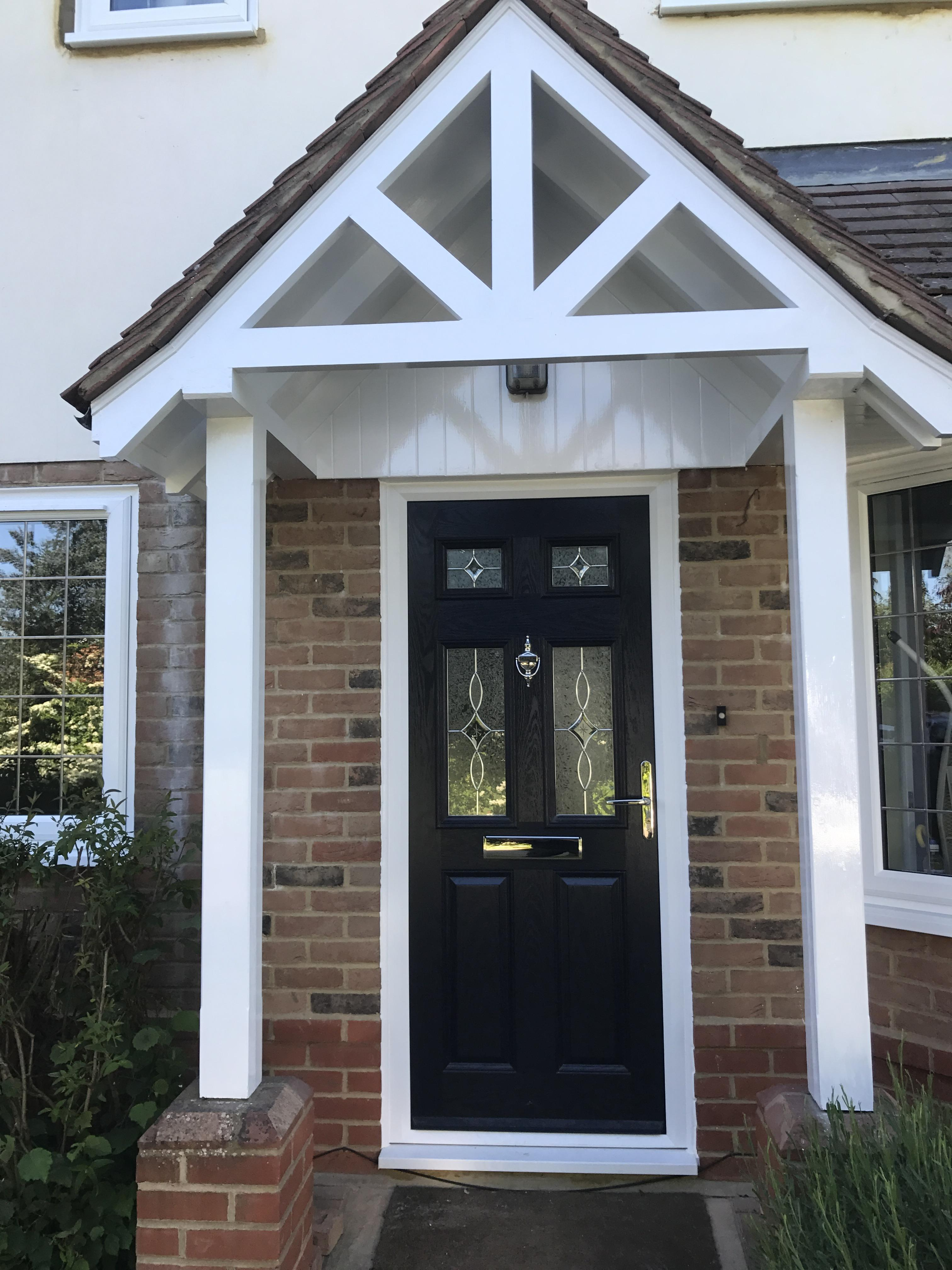 Black High Performance Composite door with glass design and chrome furniture