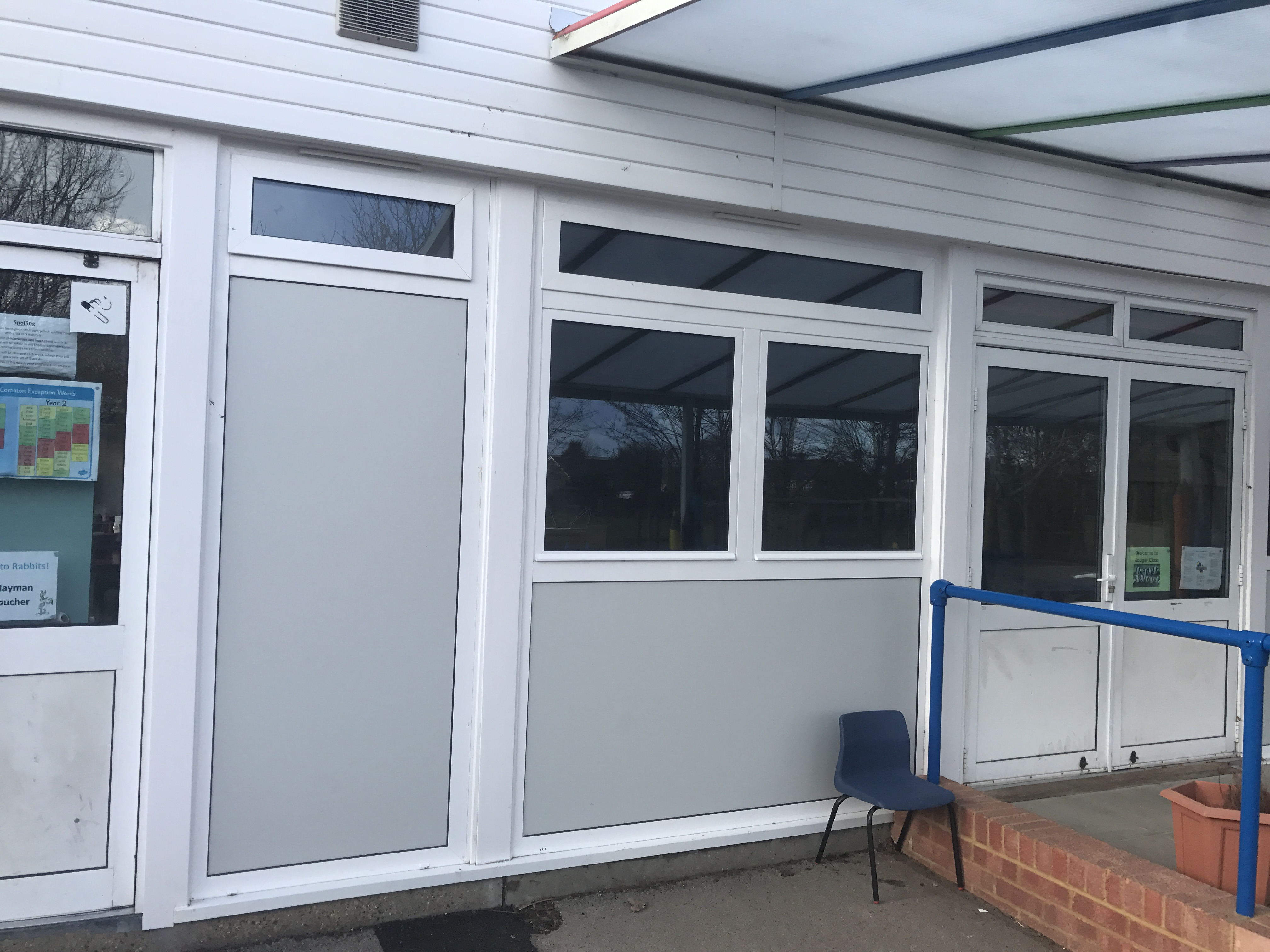 Fitted into part of a university includes all panels to the side and below windows