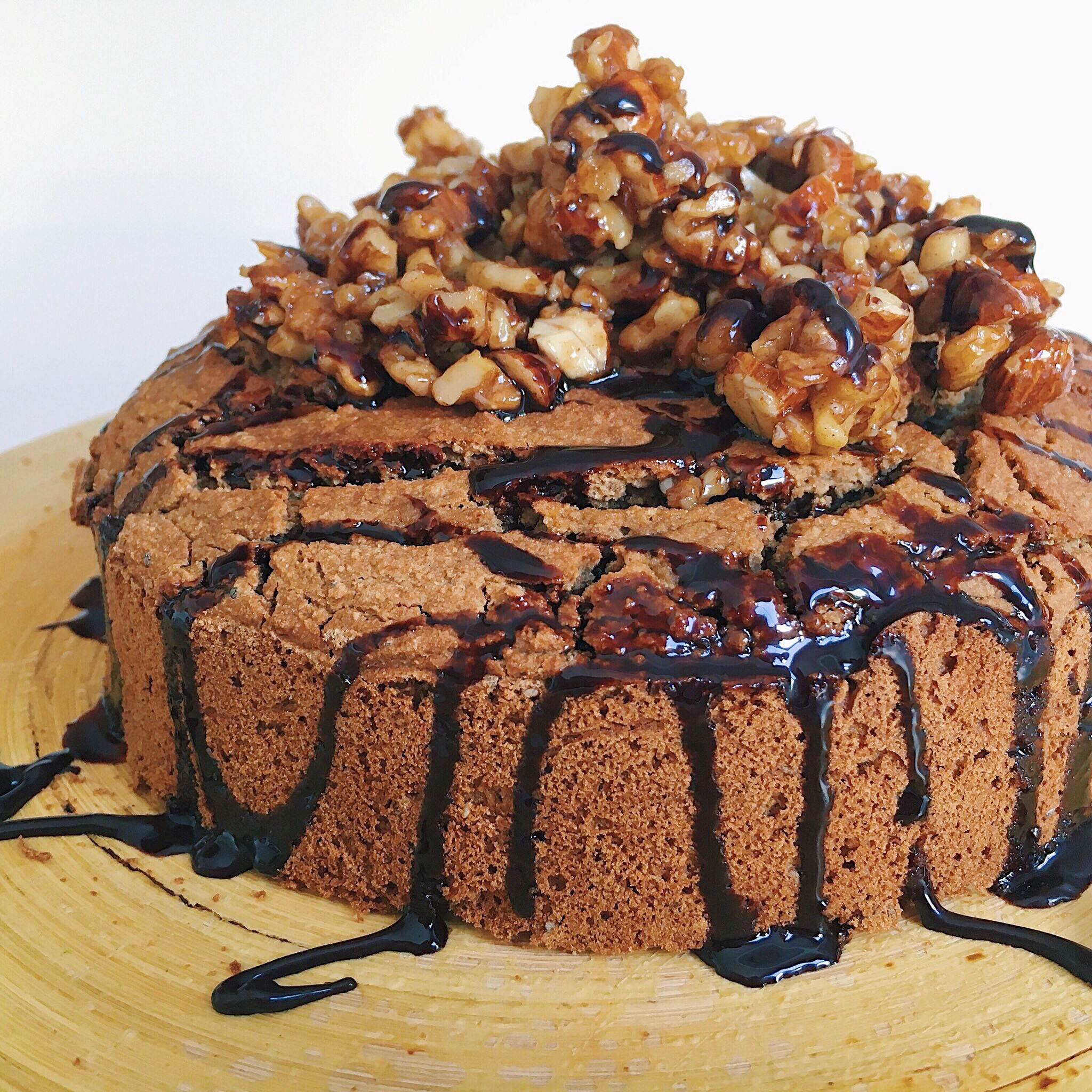 Vegan coffee and banana cake with candied nut brittle and chocolate sauce