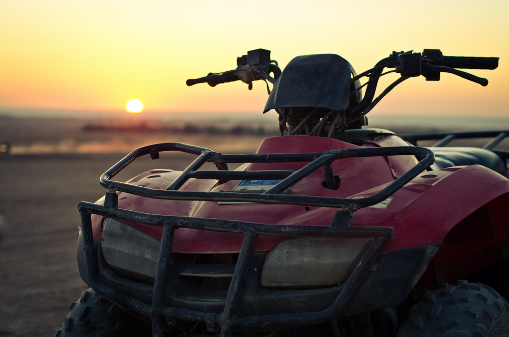 Quad bike setting sun.