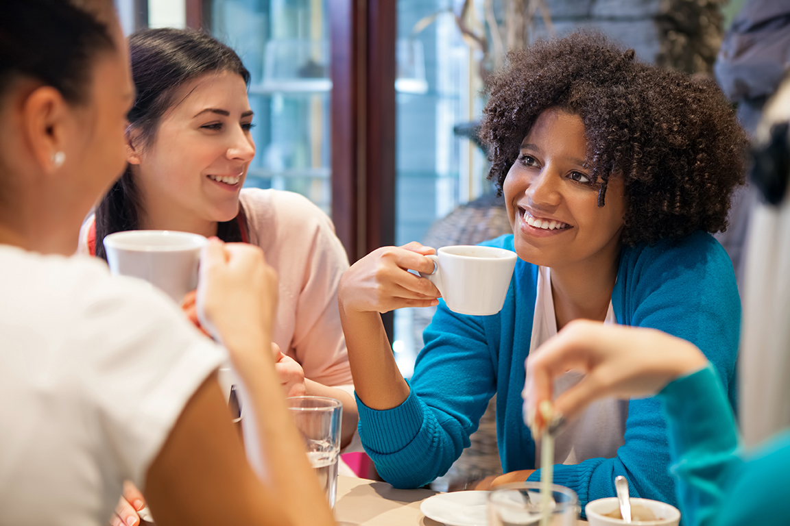 women talking in cafe
