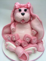 Giant pink floppy bunny rabit cake. ideal for christenings . A real girly cake