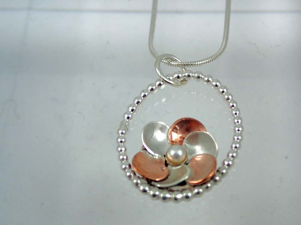 Pearl copper and silver beaded oval flower pendant