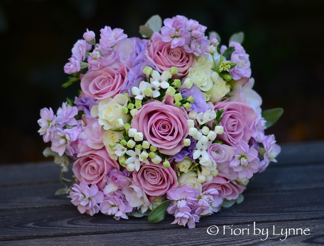pink-lilac-ivory bouquet of rose, freesia, lisianthus,bouvardia,stock.jpg
