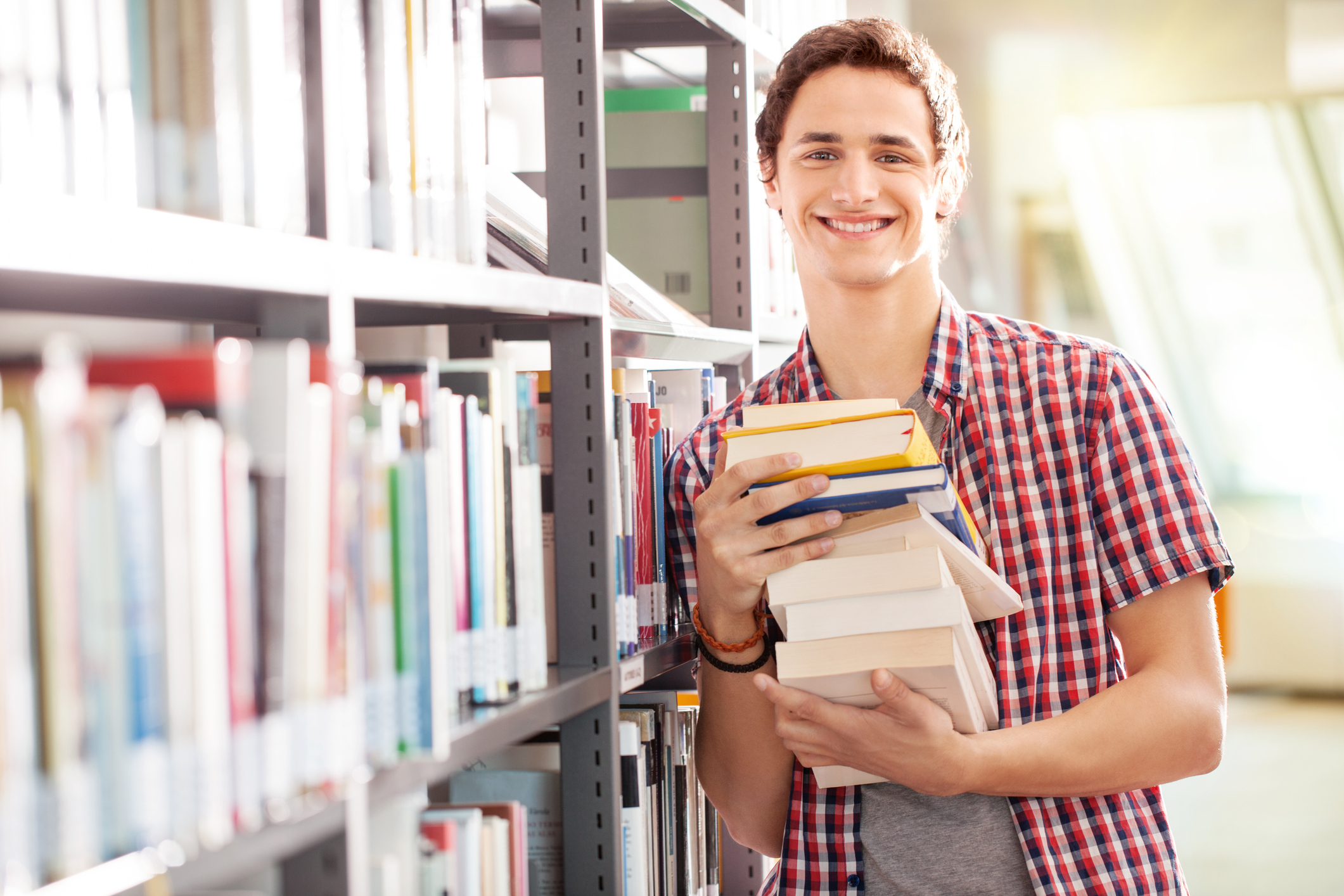 young-student-with-books-in-libraryjpg