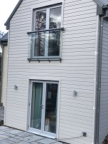 Upper level French doors opening in with Glass Juliet Balcony.  Low level French doors opening out.