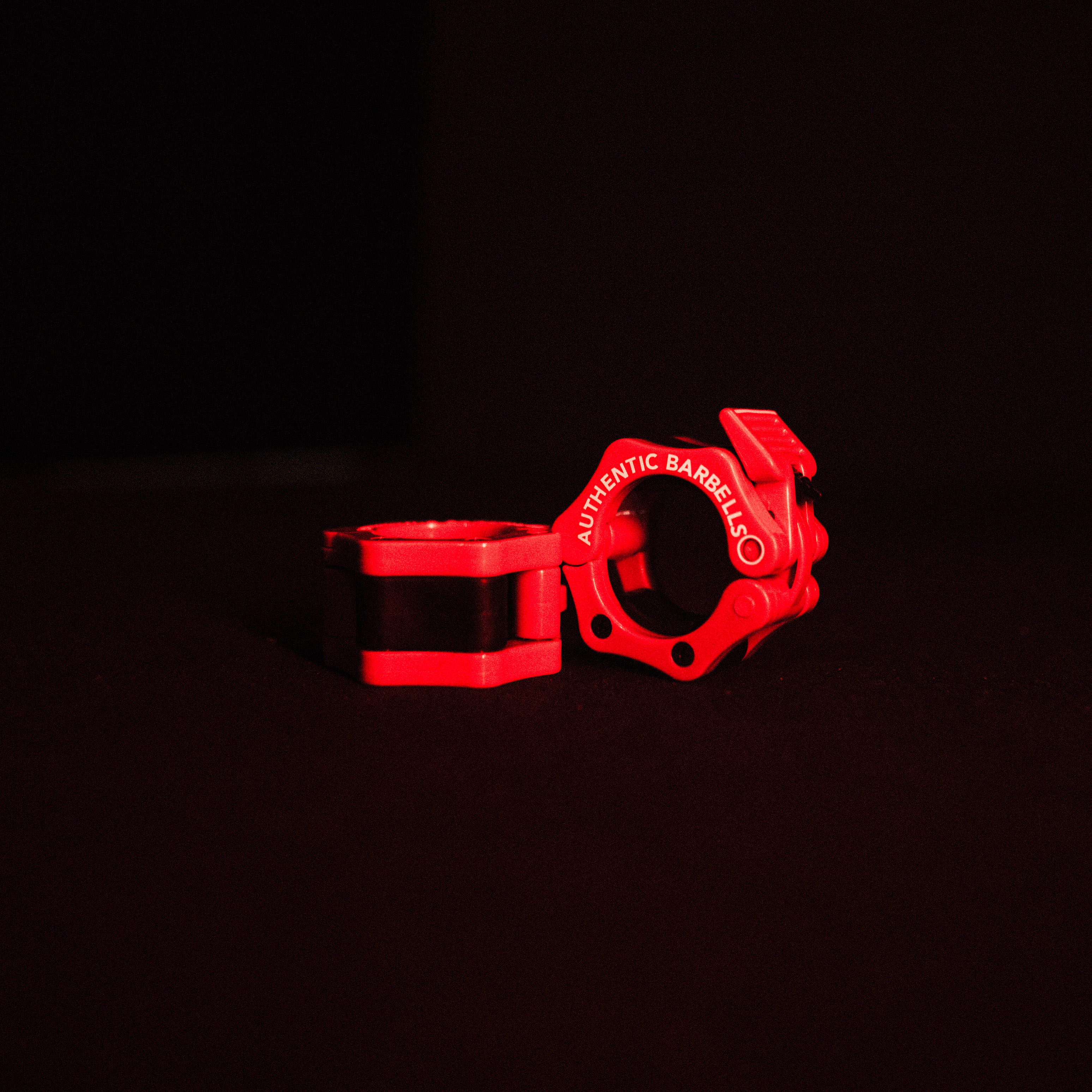 Energetic Red Barbell Clamp