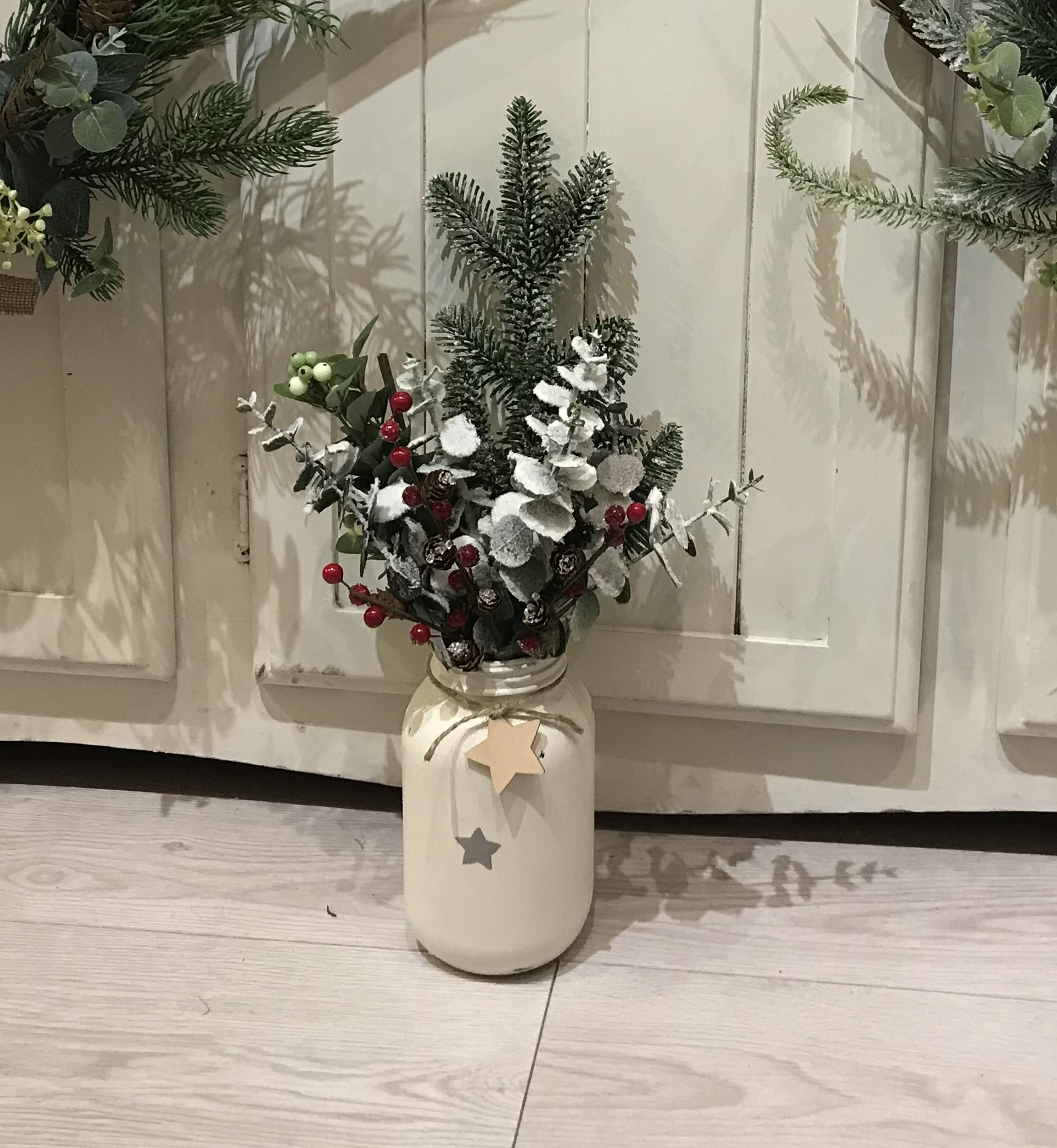 Painted jar with Christmas sprigs